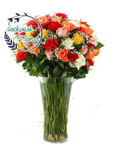 Five Dozen Mixed Roses In A Vase