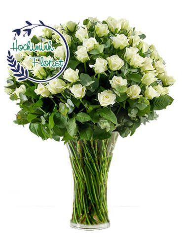 Five Dozen White Roses In A Vase