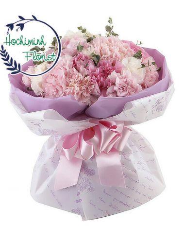 4 Dozen Pink Carnations In A Bouquet