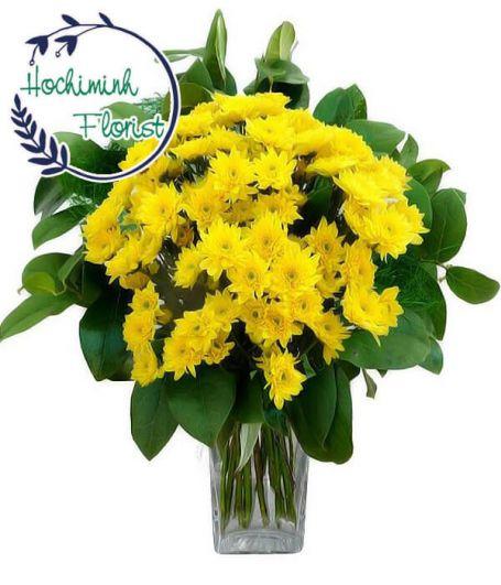 4 Dozen Yellow Gerberas In A Vase