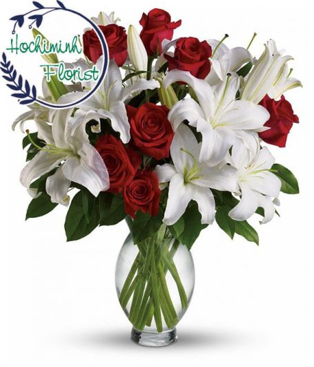 1 Dozen White Lilies And Roses In A Vase
