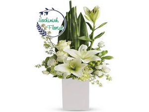 1 To 11 White Lilies In A Vase