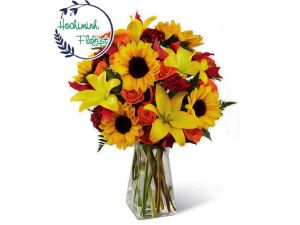 Sunflowers And Roses In A Vase