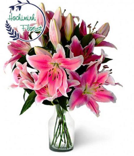 3 Dozen Pink Lilies In A Vase