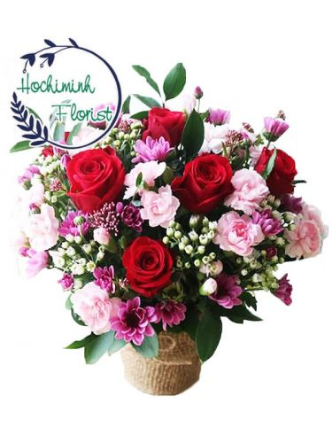 2 Dozen Pink Carnations And Roses In A Basket