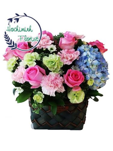 2 Dozen Mixed Carnations And Pink Roses In A Basket