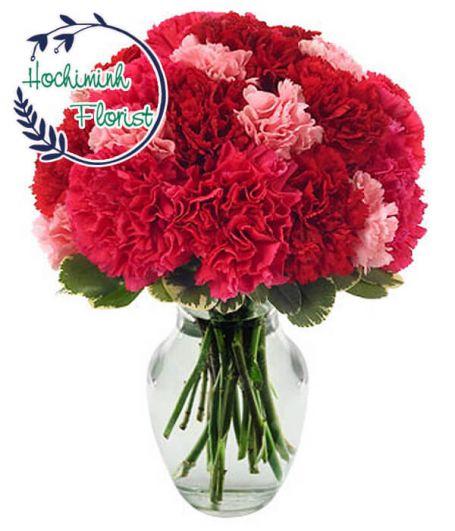 2 Dozen Mixed Carnations In A Vase