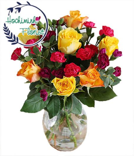 2 Dozen Mixed Carnations And Roses In A Vase